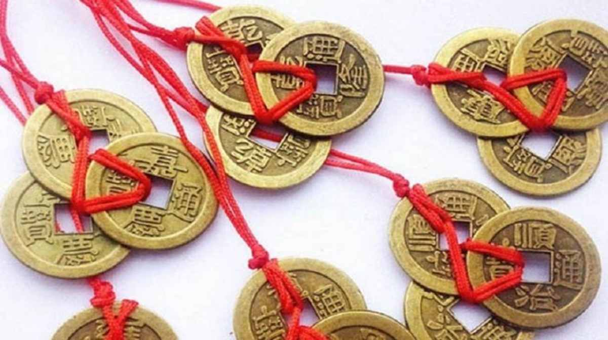 Coins tied in red ribbon